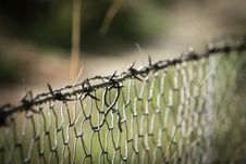Free Barbwire On Top Of Cyclone Fence Stock Photos - 83074263