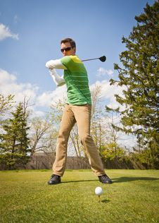 Free Man In Green And White Stripes Long Sleeve Shirt Holding Black Golf Club Stock Photography - 83074282