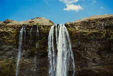 Free Brown Rock And Green Grass Beside Water Falls Stock Photos - 83074333