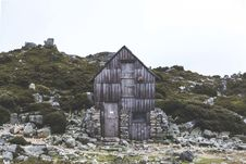 Free Gray Wooden Shack Surrounded By Gray Concrete Slab And Green Grass Field Stock Photo - 83074410
