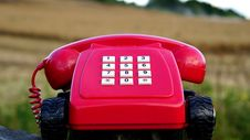 Free Red Rotary Phone With Black Wheels Near Brown Grasses During Day Time Stock Image - 83074721