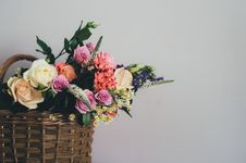 Free White Pink Rose On Brown Wicker Basket Near White Wall Royalty Free Stock Photos - 83074888