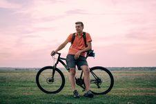 Free Man On Bike At Sunset Stock Photos - 83075013