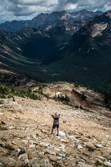 Free Hiker On Rocky Hillside Royalty Free Stock Photos - 83075348