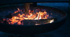 Free Round Fire Pit With Burning Wood Royalty Free Stock Photo - 83075375
