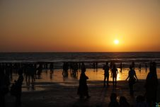 Free Silhouettes Of People On Beach At Sunset Stock Photos - 83075383