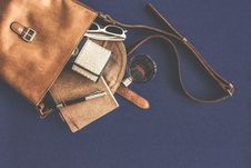 Free Brown Leather Crossbody Bag With White Framed Sunglasses Royalty Free Stock Image - 83075596