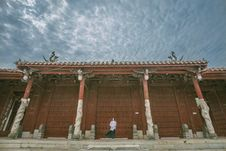 Free Person Standing Near Red Gate Stock Images - 83075684