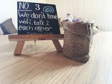 Free No 3 We Dont Have Wifi Talk 2 Each Other Text On Black Board Stock Photo - 83075880