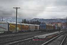 Free Train Running On Train Track Under Gray Sky At Daytime Royalty Free Stock Image - 83076246