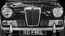 Free Car In Front View Showing Grille Royalty Free Stock Image - 83076256