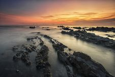 Free Rocky Beach At Sunset Stock Images - 83076754