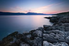Free Rocky Coastline With Smooth Sea Royalty Free Stock Images - 83076829