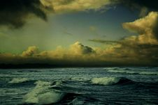 Free Ocean Waves With Golden Clouds Stock Images - 83076834