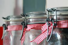 Free Clear Glass Mason Jar With Red White Ribbon Stock Image - 83076981