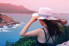 Free Wman Holding Wricker Shade Hat On Ocean View Stock Image - 83077091