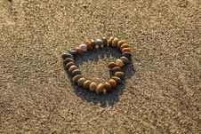 Free Brown And Grey Stone Formed Heart On Sand Stock Image - 83077201