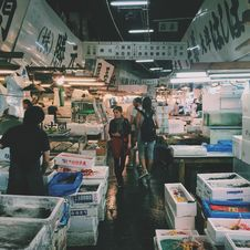 Free Person Waling On Market In Meat And Fish Section Royalty Free Stock Image - 83077296