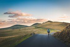 Free Man Riding His Bicycle Passing Through Mountain Road Stock Images - 83077324