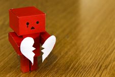 Free Crying Figure With Broken Heart Royalty Free Stock Photography - 83077477