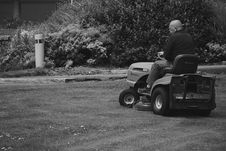 Free Man In Black Polo Shirt Riding Riding Mower Stock Photography - 83077602