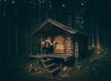 Free Woman Wearing Gray Shirt In Front Of Brown Wooden Cabin At The Forest Stock Photo - 83077610