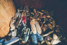 Free White Converse All Star Chuck Taylor High Tops Sneakers Surrounded By Black Red And White Shoes Stock Photography - 83077942