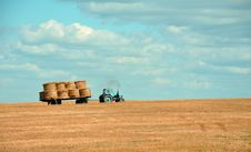 Free Tractor With Hay Bales On Trailer Stock Photos - 83078103