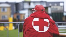 Free Man In Red Cross Jacket Stock Image - 83078271