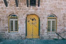 Free Brown Wooden Door And Yellow Metal Window Grills Stock Image - 83078321