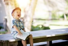 Free Laughing Boy Sitting On Table During Daytime Stock Image - 83078541