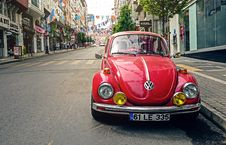 Free Red Volkswagen Beetle Parked At Road Side Near Pedestrian Lane Royalty Free Stock Photography - 83078937