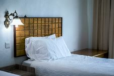 Free White Bedding Cover Beside Brown Wooden Side Table Royalty Free Stock Image - 83079226