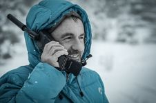Free Man In Blue Hoodie Jacket Holding Black Radio Receiver During Snowy Day Time Stock Images - 83079354