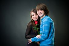 Free Cheerful Couple With Rose Royalty Free Stock Photos - 8316688