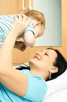 Mother And Baby On The Bed Stock Photography