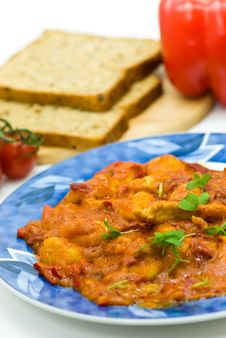 Slice Of Meat With Dumplings-Gnocchi- And Red Bell Royalty Free Stock Photography