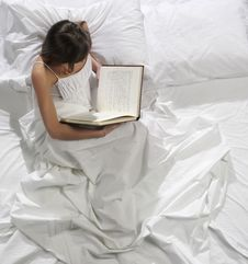 Free Woman Reads A Book In Bed Stock Photo - 8318760