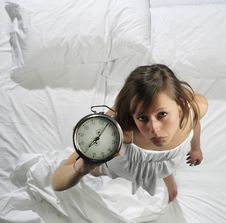 Woman With Alarm Clock Stock Photos