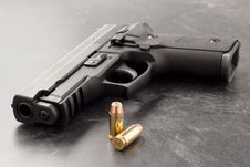 Free Handgun And Bullets Royalty Free Stock Image - 8323076