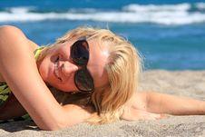 Free Beautiful Girl Lies On  Beach Stock Photo - 8323310