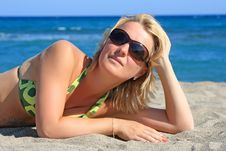 Free Beautiful Girl Lies On  Beach Stock Image - 8323311