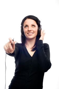 Young Brunette Is Listening To Music Stock Image