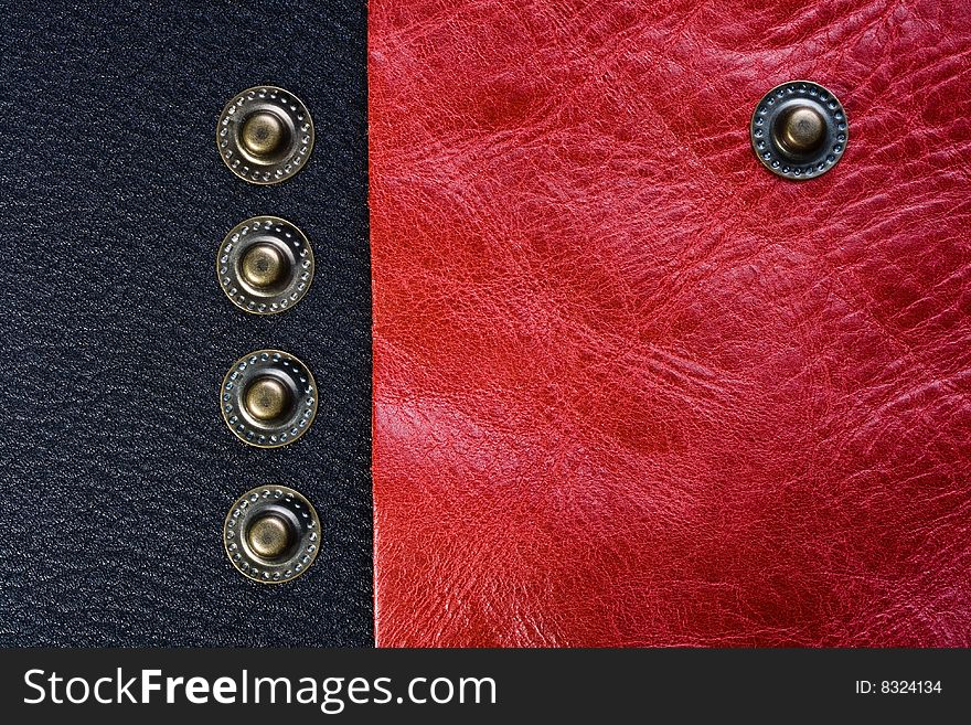 Five buttons on the black and pink leather