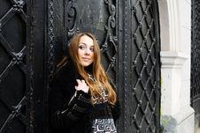 Free Girl At Black Door Royalty Free Stock Image - 8331496