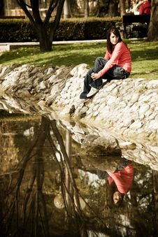Free Woman Sitting Near The River Royalty Free Stock Photos - 8333498