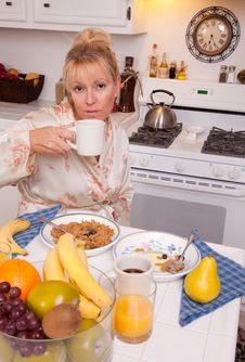 Attractive Woman In Kitchen Stock Images