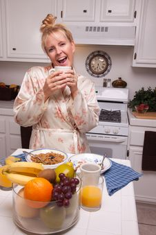 Expressive Woman In Kitchen Royalty Free Stock Photo