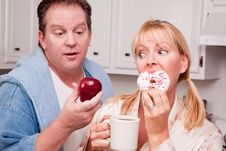 Free Fruit Or Donut - Healthy Eating Decision Royalty Free Stock Photography - 8333837