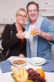 Free Businesswoman With Husband In Kitchen Stock Photography - 8333872